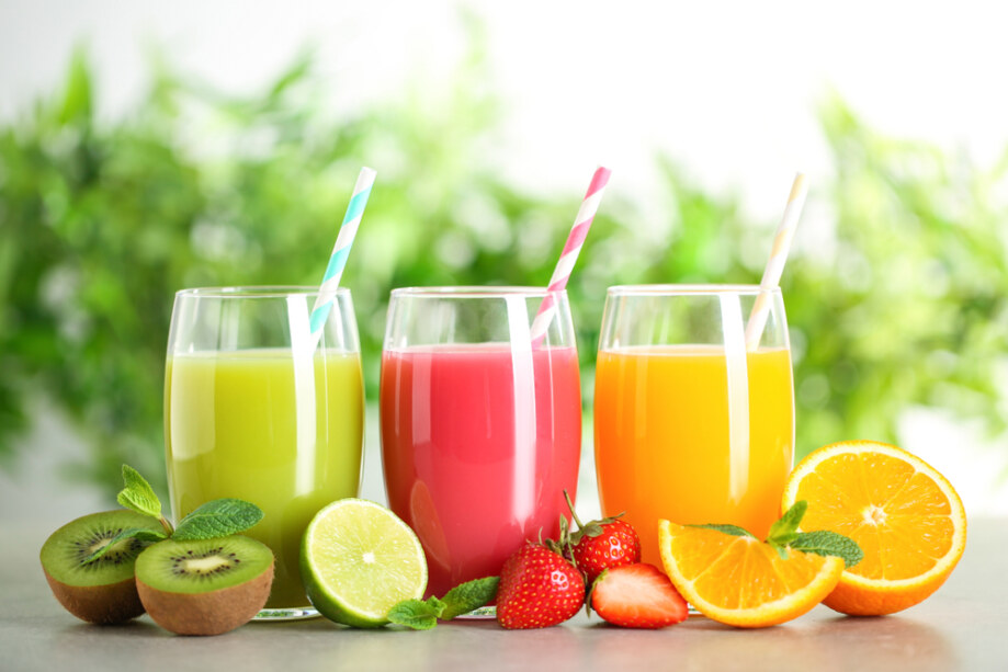 Glasses,Of,Different,Juices,With,Straws,And,Fresh,Fruits,On